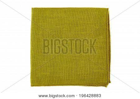 Green folded textile napkin isolated on white background