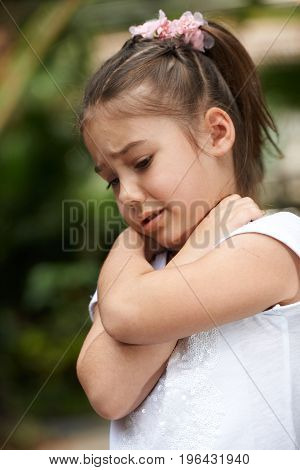 Little girl crying and hug self by hands emotion outdoor photo