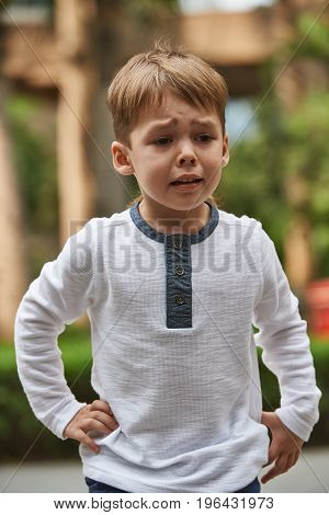 Little boy crying emotion outdoor close up photo