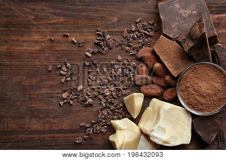 Composition of cocoa products on wooden table