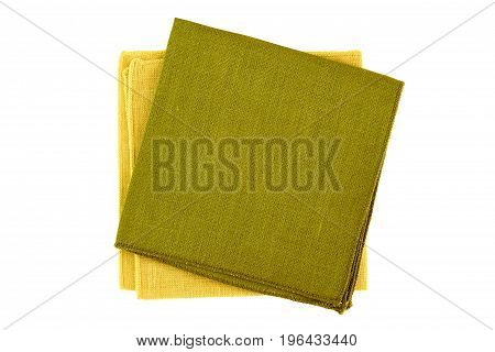Green and yellow textile napkins isolated on white background