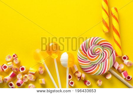 Tasty candies on color background