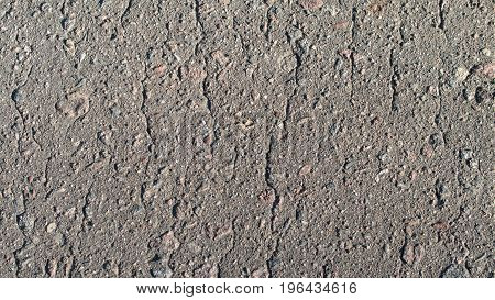 The texture of asphalt with small stones.
