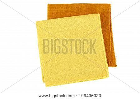 Yellow and orange textile napkins isolated on white background