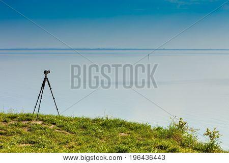 Camera With Tripod On Coastal Cliff