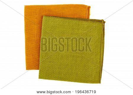 Green and orange textile napkins isolated on white background