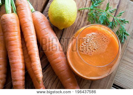 Carrot Juice With Fresh Carrots In The Background