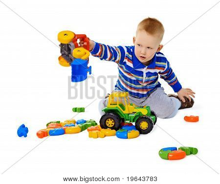 Little Boy Playing Actively With Plastic Toys