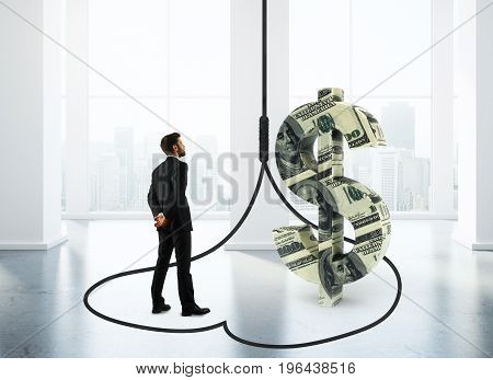 Thoughtful businessman inside abstract dollar trap in interior. Investment and danger concept. 3D Rendering