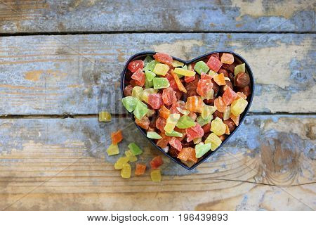 Candies in a heart shaped box, top view