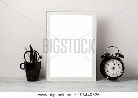 White frame mock up with pencil and alarm clock. Modern stylish interior background for social media and marketing.