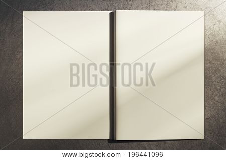 Back view of open white hardcover notepad on concrete background. Mock up 3D Rendering
