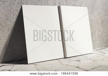 Side view of open white hardcover notebook leaning on concrete wall. Abstract supplies stationery items. Mock up 3D Rendering