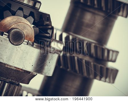 Differential transmission gearbox detailed closeup. Automobile machinery engineeing industrial objects and details concept.