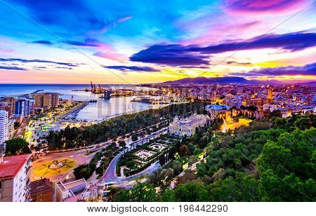 Scenic view of Malaga, southern Spain, at dusk, showing the port and its surroundings