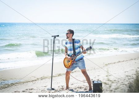 The Guy On The Beach With Musical Instruments