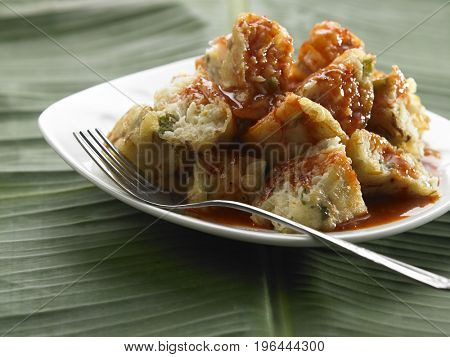 cucuk sayur with chilli paste on the banana leaf