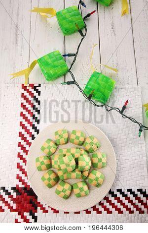 Top view checker cookies and ketupat light