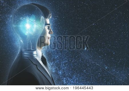 Side portrait of abstract lamp headed businessman in space. Inspiration concept. Double exposure