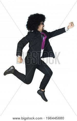 Portrait of Afro businessman jumping and running isolated on white background