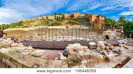 Sunset view of the Alcazaba fortress and the Roman theatre in Malaga, Spain