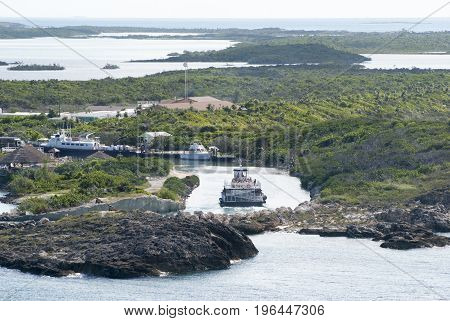 The tender boat bringing tourists to little Caribbean island Half Moon Cay (Bahamas)
