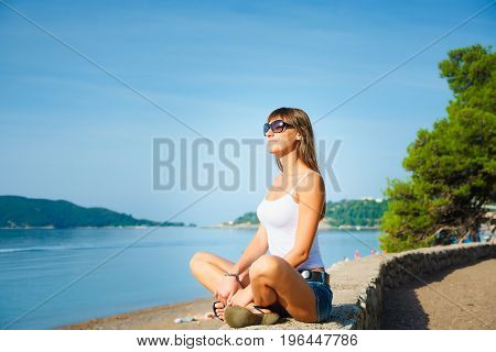 Beautiful Young Woman Looking At The Sea. Montenegro, Europe.