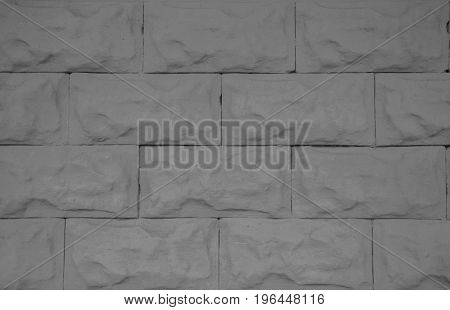 Rectangular gray tile brick concrete fence close-up for background