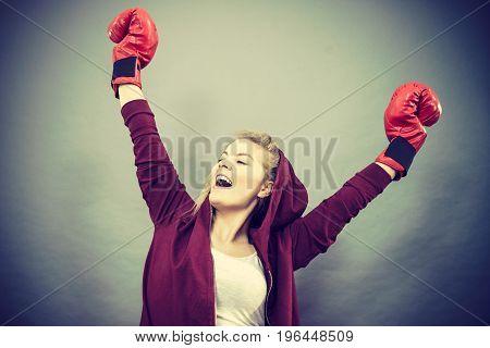 Woman Winner Wearing Boxing Gloves