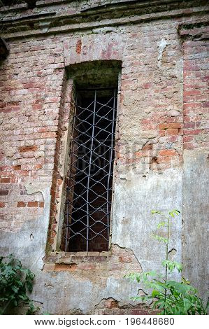 Window of the ruined temple of St. Nicholas in the village of Gribny. Russia, Tver region.
