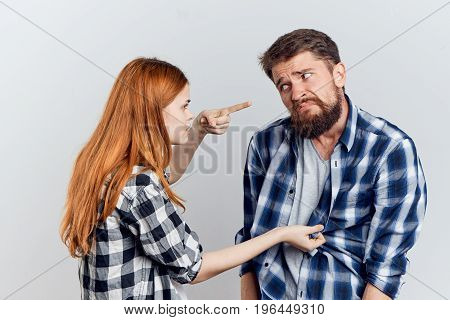 Young beautiful woman with a guy with a beard on a white isolated background holding construction tools, repairing, building.