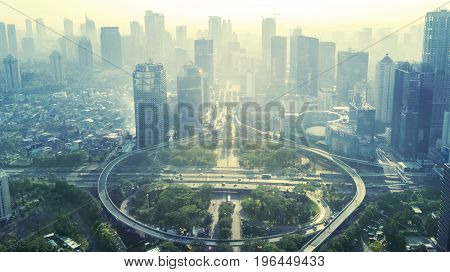 Aerial view of the new Semanggi road intersection in Jakarta Indonesia. Shot in the misty morning