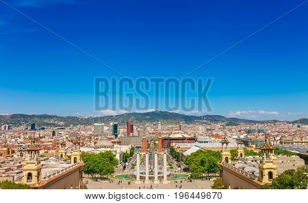 Skyline Landscape Of Beautiful Barcelona From The Montjuic In A Clear Blue Sky And Sunny Day. Famous