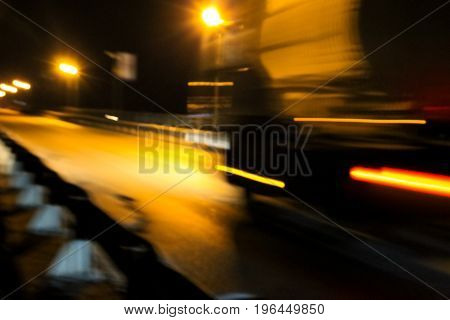 Blurred Traffic Light Trails On Road At Night