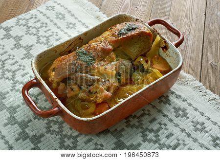 Pjachisto - Stewed pork ham.Slavic cuisine close up meal