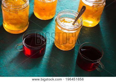 Banks with pineapple jam and tea on the table horizontal