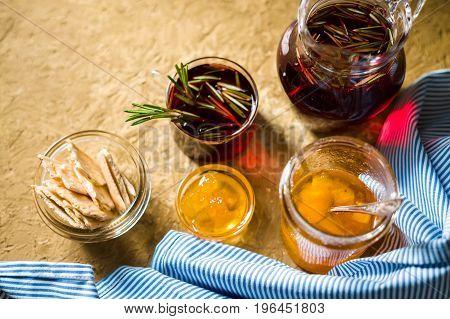 Tea with rosemary, pineapple jam and blue striped napkin horizontal