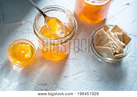 Jam from pineapple in jars on a white background and cookies horizontal