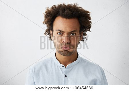 Isolated Studio Shot Of Unhappy Grumpy Serious Young African American Manager With Afro Hairstyle Fr
