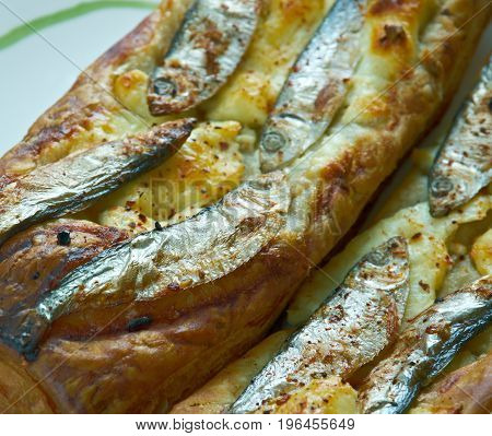 Pastry tart with anchovies. French cuisine . close up meal