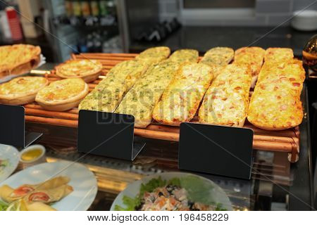 Counter with tasty bakery products in shop
