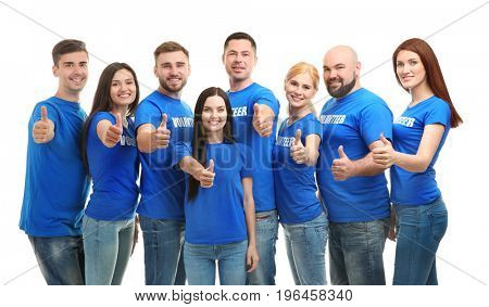 Young volunteers showing thumbs up on white background