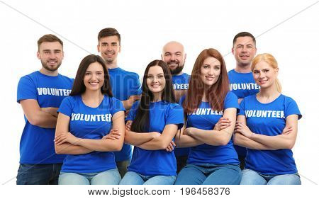 Group of young volunteers on white background