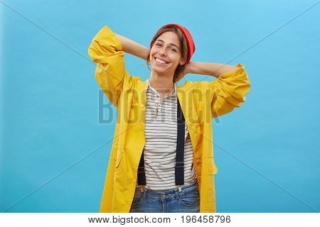 Happy Charming Young Female Feeling Excited, Going For A Walk In Rainy Weather, Keeping Hands Behind