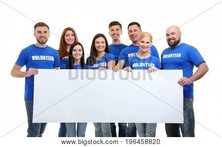 Group of young volunteers with blank poster on white background