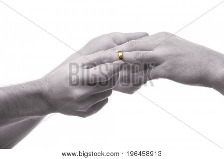 Man putting wedding ring on groom's finger on white background. Gay rights concept