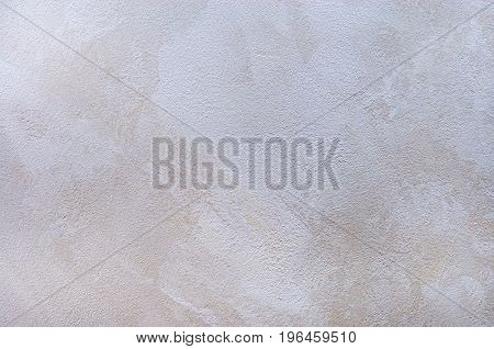 Textured background. Decorative plaster walls, external decoration of facade. Smears.