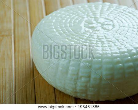 Traditional Caucasian homemade cheese sulguni. close up