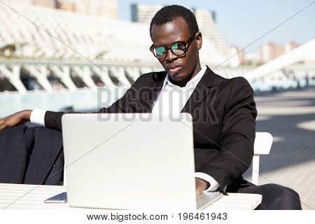 People, Business, Occupation And Technology Concept. Serious Concentrated Male In Eyewear Dressed Fo