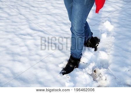 Close-up Of Women's Legs Against White Snow